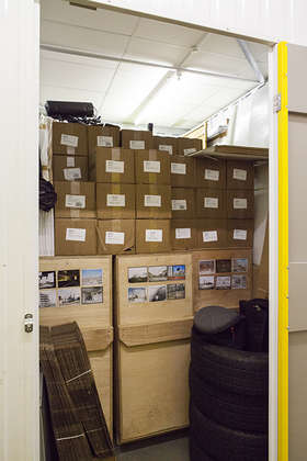 Crates of exhibition prints and publications in Mark Power's lock-up